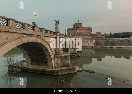 Aurelius bridge with the Castle Sant'Angelo in the morning at dusk in the center of the historic center of Rome. Historic streets. Lighting on the bri - Stock Photo