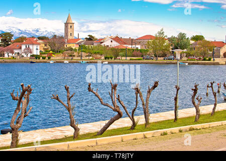 Historic town of Nin waterfront view, Velebit mountain background, Dalmatia region of Croatia - Stock Photo