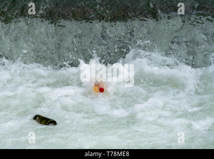 Image of plastic and glas bottles in water - Stock Photo