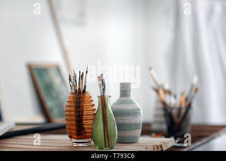 Set of paintbrushes on table in workshop Stock Photo