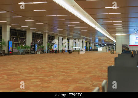 T3 terminal at Indira Gandhi International (IGI) Airport, New Delhi, India, wears a deserted look, early morning. IGI is the busiest airport in India. - Stock Photo