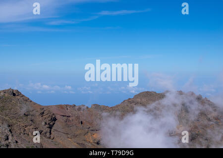 Above the clouds, volcanic landscape at Roque de los Muchachos, the highest point on La Palma Island, Canaries - Stock Photo
