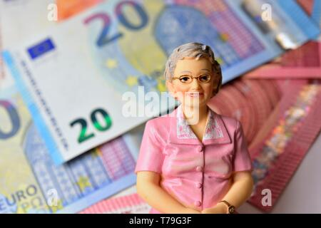 Single female old aged pensioner with euro notes blurred in the background. money retirement concept