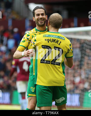 Norwich City's Mario Vrancic celebrates scoring his side's second goal of the game with Teemu Pukki during the Sky Bet Championship at Villa Park, Birmingham. - Stock Photo