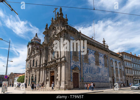 Blue and white tiles on wall of church Igreja das Carmelitas in the centre of Porto, Portugal. - Stock Photo
