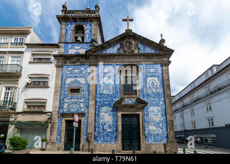 Capela das Almas Church in Porto, Portugal. Blue azulejo tiled exterior facade. - Stock Photo