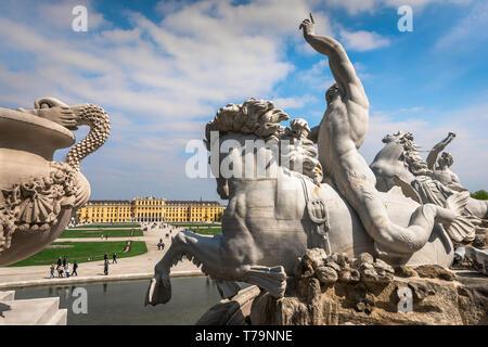 Schloss Schonbrunn, view of a triton riding a seahorse on the Neptune Fountain with the Schloss Schönbrunn palace in the distance, Vienna, Austria. - Stock Photo