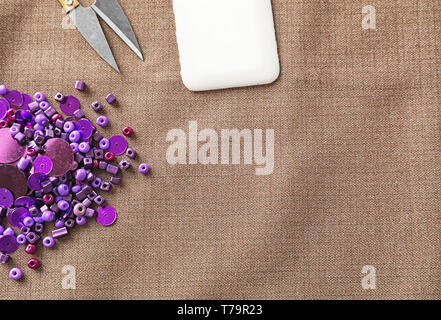 Sewing accessories on fabric - Stock Photo