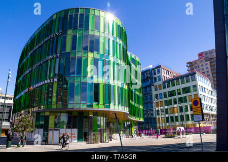Street view and modern architecture with the green Glass Vase in Malmo, Sweden - Stock Photo