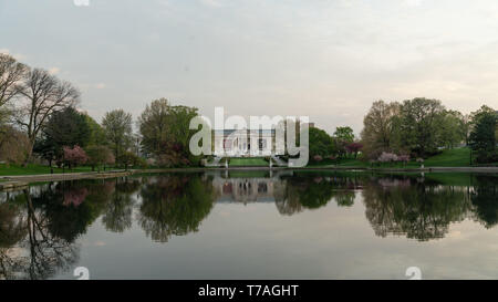 Cleveland, Ohio/USA - May 1, 2019: The Wade Park Lagoon with the reflection of the World famous Cleveland Museum of Art. - Stock Photo