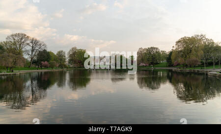 Cleveland, Ohio/USA - May 1, 2019: The Cleveland Museum of Art in the distance with closeup view of The Wade Park Lagoon. - Stock Photo