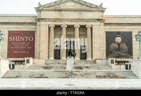 Cleveland, Ohio/USA - May 1, 2019: Cleveland Museum of Art during the early morning hours with statue posing out front. - Stock Photo