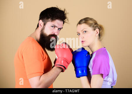 Sport for everyone. Amateur boxing club. Equal possibilities. Strength and power. Man and woman in boxing gloves. Be careful. Boxing sport concept. Couple girl and hipster practicing boxing. - Stock Photo
