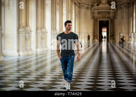 Handsome Man Looking Around Inside a Museum - Stock Photo