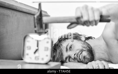 Man bearded annoyed sleepy face lay pillow near alarm clock  Break
