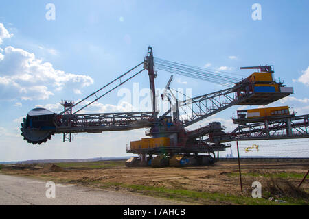 A lignite surface mine with a giant bucket-wheel excavator, one of the worlds largest moving land vehicles - image - Stock Photo