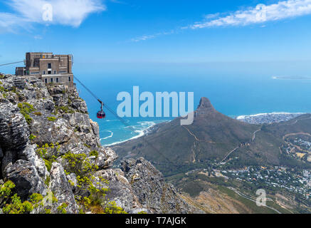 View from Table Mountain with Aerial Cableway in foreground and Lion's Head, Signal Hill and Robben Island behind, Cape Town, South Africa. - Stock Photo
