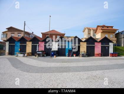 A row of houses for storage fishing material in Vila Chá Portugal, with multicolored doors - Stock Photo