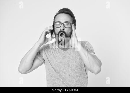 Man excited about mobile phone opportunities. Hipster cheerful use smartphone. Man happy user of modern smartphone. Stay in touch with modern smartphone. Join online community. User friendly concept. - Stock Photo