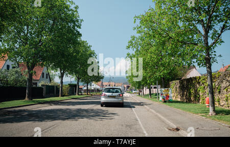 Bergheim, France - 19 Apr 2019: Rear view of VW polo silver car driving in Alsatian village - Stock Photo