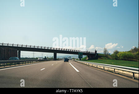 France - Apr 19, 2019: Driver point of view POV at french highway with cars driving fast under the bridge - Stock Photo