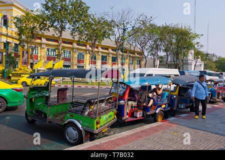 Tuk Tuks, in front of Wat Pho, Phra Nakhom district, Bangkok, Thailand - Stock Photo