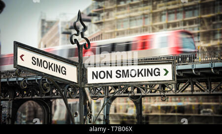 Street Sign the Direction Way to Smoking versus Non Smoking - Stock Photo