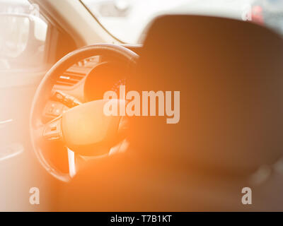 View to the black color interior of car with front seats, steering wheel and dashboard . Auto service industry - Stock Photo