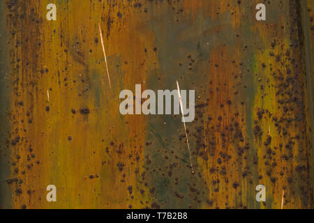 Various colors of the paintings, partly peeled off, partly rusted. Detail of an old metal gate. Arico Nuevo, Tenerife, Canary Islands, Spain. - Stock Photo