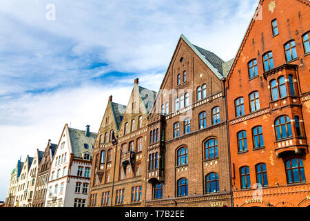 Brick buildings with gables reconstructed to match the historic hanseatic buildings in Bryggen, Bergen, Norway - Stock Photo