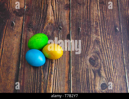 Beautiful colorful Easter eggs. Easter concept on dark wooden background - Stock Photo