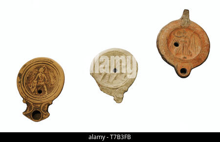 Roman lamps. Clay. 1st century AD. From left to right: Gladiator (Urso, Osuna, Sevilla province, Andalusia), Gladiators (Iponuba, Baena, Cordoba province, Andalusia) and Goddess Victoria (El Djem, Tunisia). National Archaeological Museum. Madrid. Spain. - Stock Photo