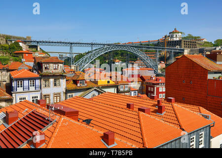 The Dom Luis I metal arch bridge and orange tiled roofs of Porto, Portugal