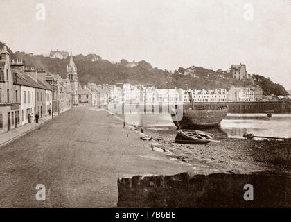 A late 19th Century view of the seafront of Tobermory, the capital of Mull, and until 1973 the only burgh on, the Isle of Mull in the Scottish Inner Hebrides. It is located on the east coast of Mishnish, the most northerly part of the island, near the northern entrance of the Sound of Mull. The town was founded as a fishing port in 1788, its layout based on the designs of Dumfriesshire engineer Thomas Telford. - Stock Photo