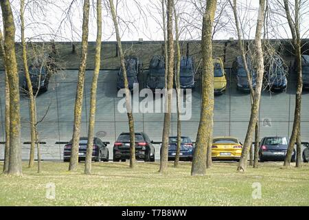 Kaunas, Lithuania - April 17, 2018: cars parked near the mirror house in the elite district of the city - Stock Photo