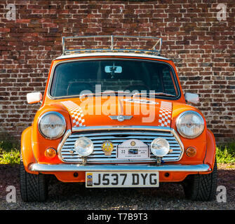 Vintage 1991 orange Rover Mini Cooper parked at Archerfield Estate, North Berwick Rotary Club Classic Car Tour 2019, East Lothian, Scotland, UK - Stock Photo