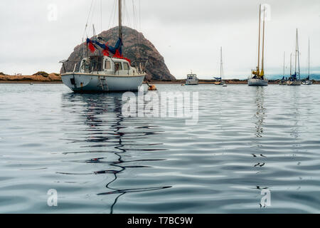 Sailing Boats Docked at  Morro Bay Harbor. Beautiful Reflection on the Water, Morro Rock in Background - Stock Photo