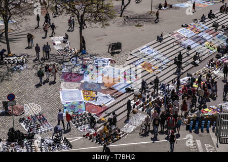 May 5, 2019 - Barcelona, catalonia, Spain - A large area of the port is seen occupied by street vendors known as ''the manteros'' offering their goods, mainly shoes, bags, glasses, hats.The sale and purchase of products on the street offered by the street vendors popularly called ''manteros'' is prohibited in Barcelona. The proximity of the municipal elections has revitalized the police devices to avoid the sale after a long period of permissiveness by the Barcelona City Council. The new police devices are concentrating the ''manteros'' in a single area of the port, which is now being oversu - Stock Photo