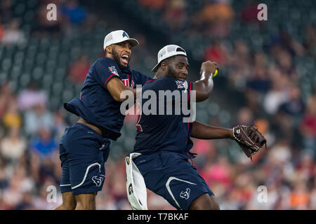 May 04, 2019 Houston Texans nose tackle Brandon Dunn (92) and cornerback Aaron Colvin (22) during the JJ Watt Charity Classic, a softball game that provides funding for after-school athletic programs enhancing opportunities for middle-school aged children in the community to become involved in athletics, so that they may learn the character traits of accountability, teamwork, leadership, work ethic and perseverance, while in a safe and supervised environment with their peers Maria Lysaker/CSM - Stock Photo