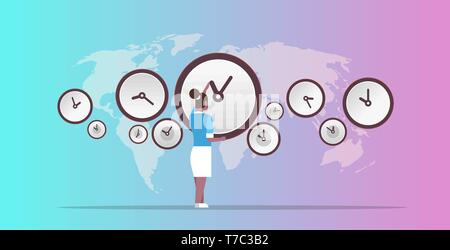 businesswoman pointing on wall with clocks different cities time management deadline concept african ameriscan business woman over world map - Stock Photo