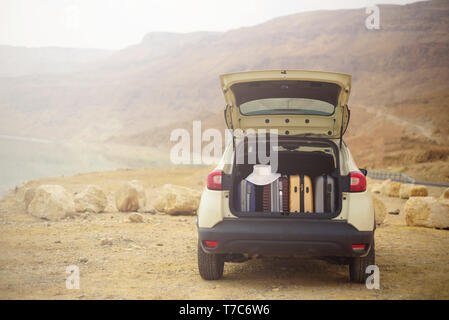 Suitcases and bags in car trunk. Summer holidays. Travel, adventure concept - Stock Photo