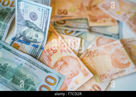money background with american dollars and turkish liras, hundred dollars and fifty turkish liras background. random moneys, economic and financial cr - Stock Photo