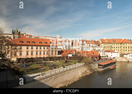 beautiful Praha city scenery with Prazsky hrad on the background from Karluv most bridge in Czech republic during nice early spring day - Stock Photo