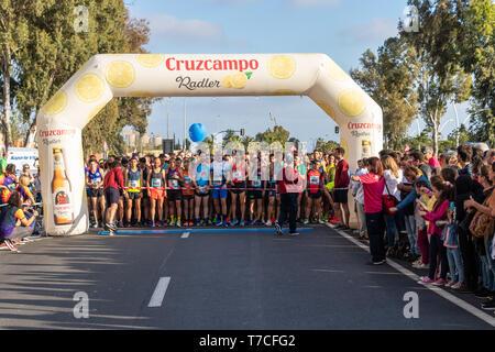 Huelva, Spain - May 4, 2019:  Runners at the start of the Huelva solidary 10K Run on May 2019. The first 10K race held in Huelva - Stock Photo