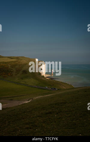 Beachy Head Lighthouse viewed from Belle Tout Lighthouse on The Seven Sisters cliffs, East Sussex, UK - Stock Photo