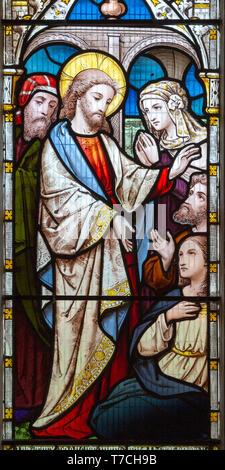 Stained glass window church Saint Michael, Peasenhall, Suffolk, England, UK circa 1868 Ward and Huges Jesus Christ Healing the Sick - Stock Photo