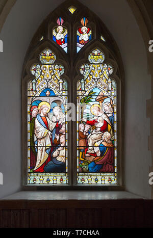 Stained glass window in church of Saint Michael, Peasenhall, Suffolk, England, UK circa 1868 by Ward and Huges two panels Jesus Christ Healing the sic - Stock Photo