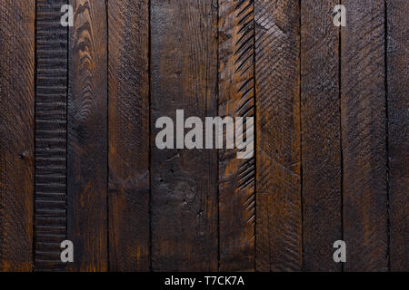 Old dark rustic wooden planks table texture top view flat lay - Stock Photo