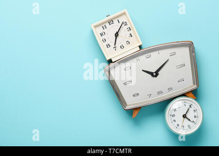 Retro alarm clocks on blue pastel background time concept flat lay top view with copy space - Stock Photo