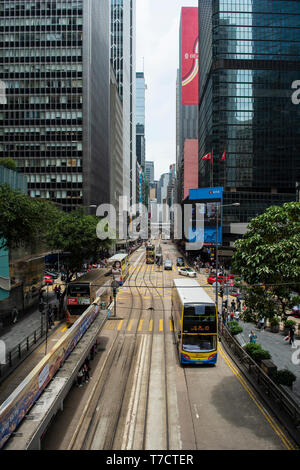 Hong Kong Streets with trams and office buildings - Stock Photo